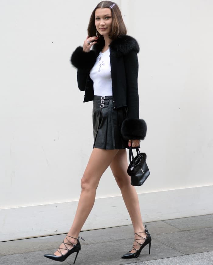 "Bella Hadid wearing a Chrome Hearts x Bella look styled with Saint Laurent ""Paris"" lace-up pumps in London"