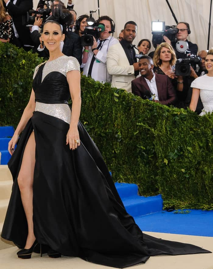 Celine Dion wearing an Atelier Versace gown and Charlotte Olympia pumps at the 2017 Met Gala