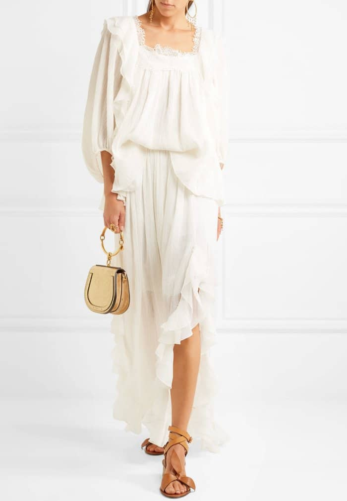 Model wearing the Chloe x Net-A-Porter bow-detailed embellished sandals in tan leather
