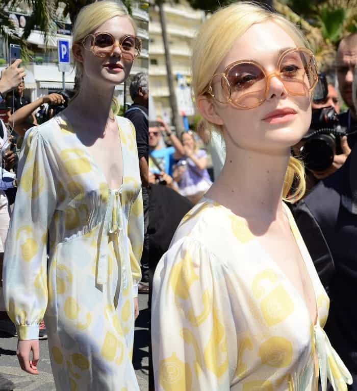"Elle Fanning wearing a Miu Miu maxi dress and Jimmy Choo ""Myla"" mules while out and about in Cannes"