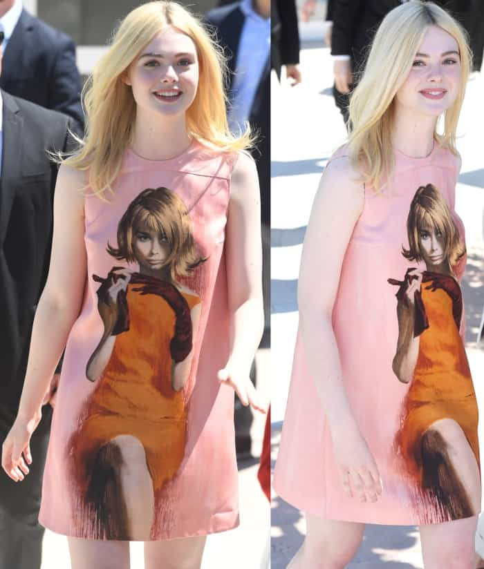 "Elle Fanning wearing a Prada fall 2017 shift dress and Laurence Dacade ""Lilas"" satin pumps at the 70th Cannes Film Festival ""How to Talk to Girls at Parties"" photocall"