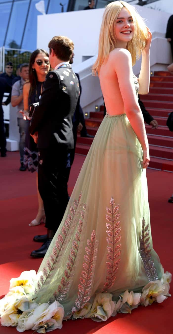 "Elle Fanning wearing a Gucci fall 2017 gown and Brian Atwood shoes at the 70th Cannes Film Festival ""How to Talk to Girls at Parties"" premiere"