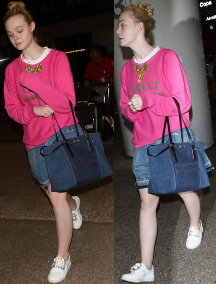 Elle Fanning wearing a Gucci logo sweatshirt, Sacai denim flared shorts, and Maison Margiela embellished buckle sneakers at LAX