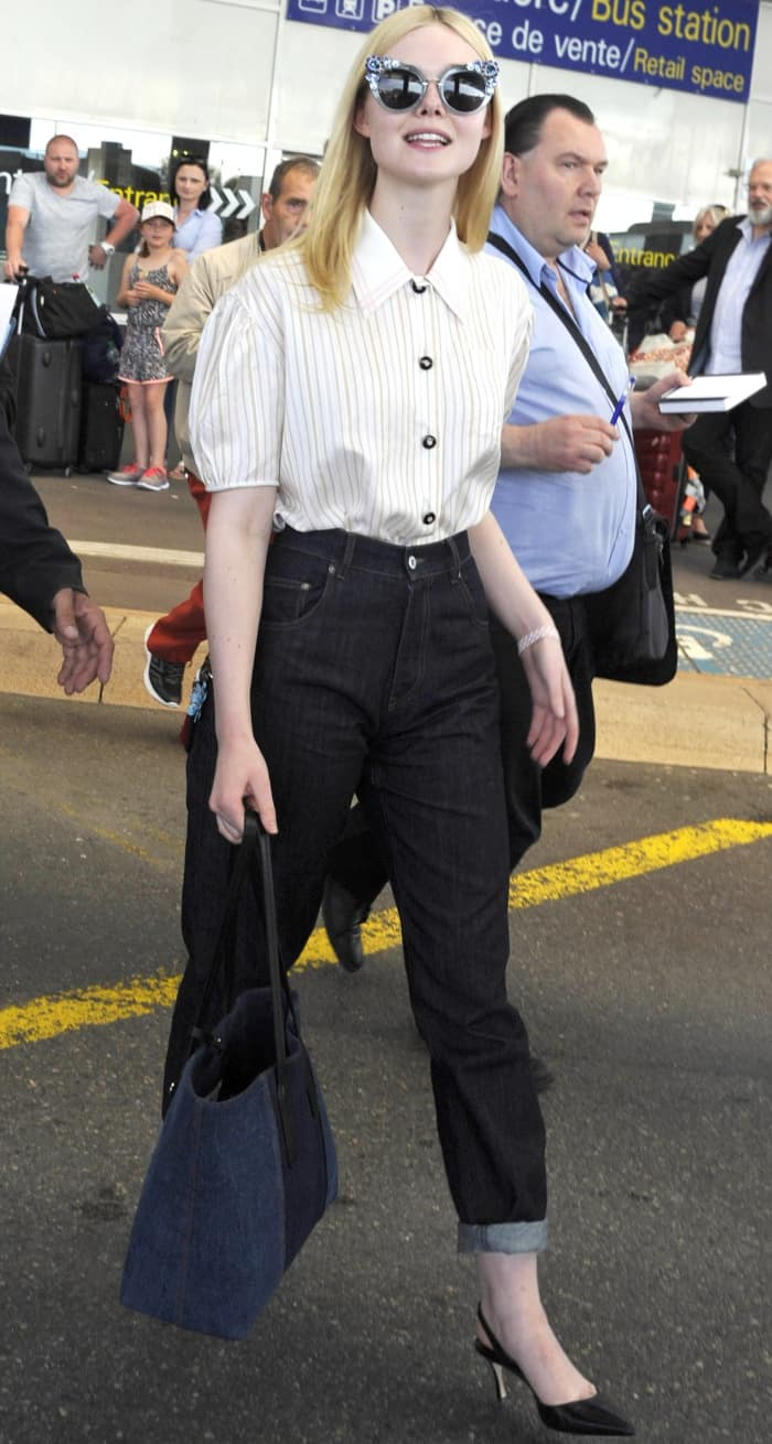 Elle Fanning wearing a Miu Miu ensemble and black slingback pumps at the Nice Cote d'Azur Airport