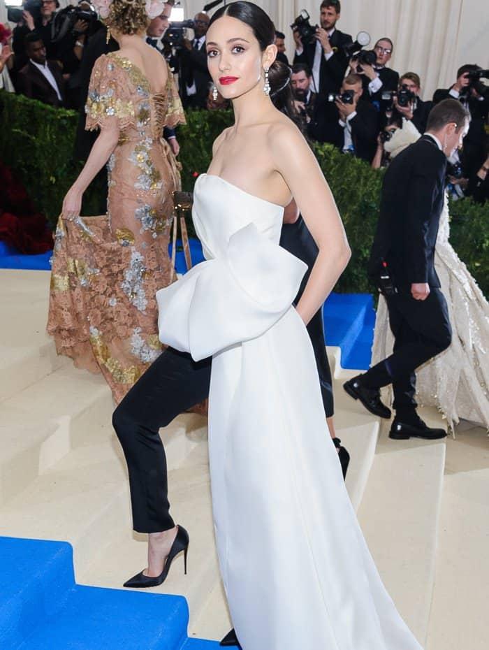 Emmy Rossum wearing a custom Carolina Herrera look and Christian Louboutin heels at the 2017 Met Gala