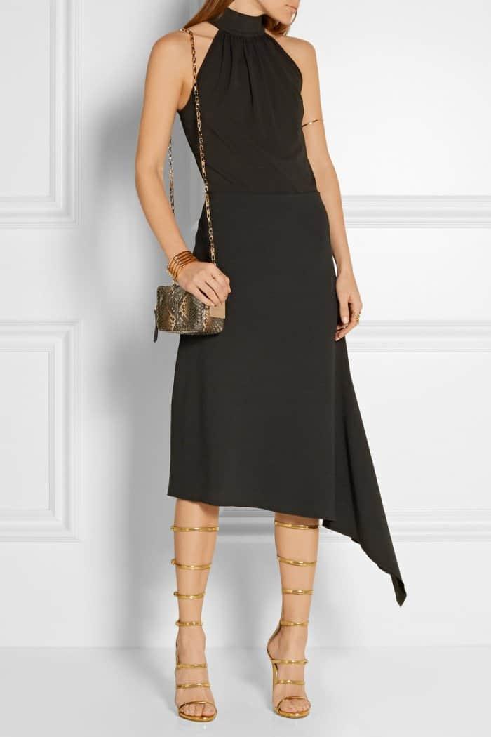 "Model wearing Giuseppe Zanotti's ""Super Harmony"" sandals in metallic gold leather"