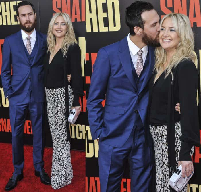 """Danny Fujikawa in a navy blue suit and Kate Hudson in a custom look from Michael Kors Collection and Giuseppe Zanotti embellished platform sandals at the LA premiere of """"Snatched"""""""