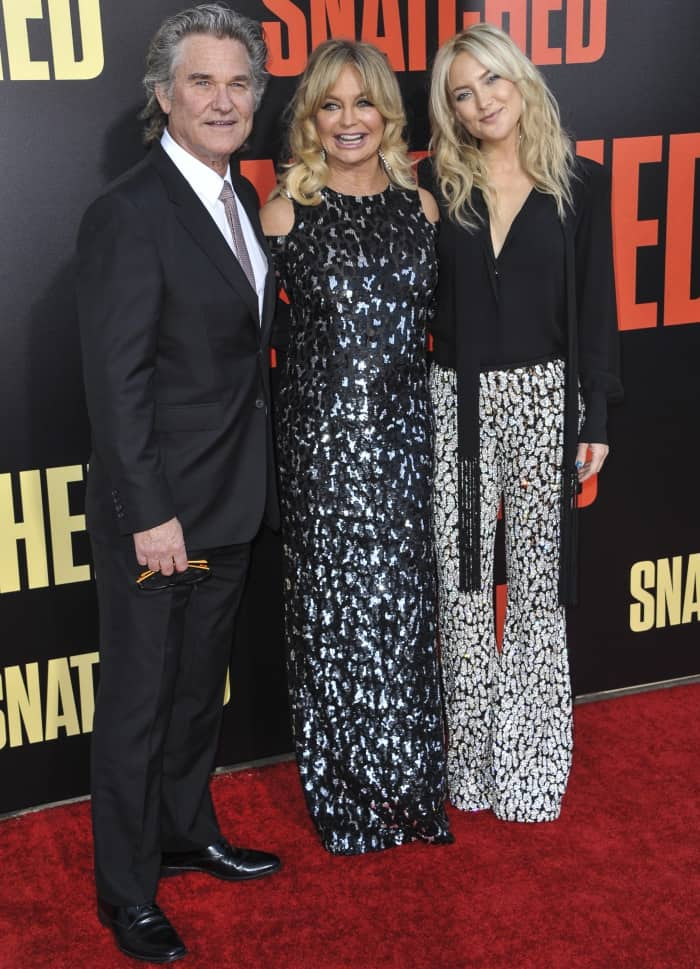 """Kurt Russell in a black suit with Goldie Hawn and Kate Hudson in custom looks from Michael Kors Collection at the LA premiere of """"Snatched"""""""