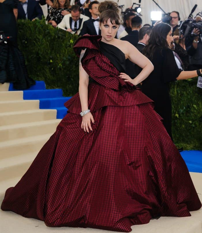Lena Dunham wearing a custom Elizabeth Kennedy gown and Jeffrey Campbell lace-up boots at the 2017 Met Gala