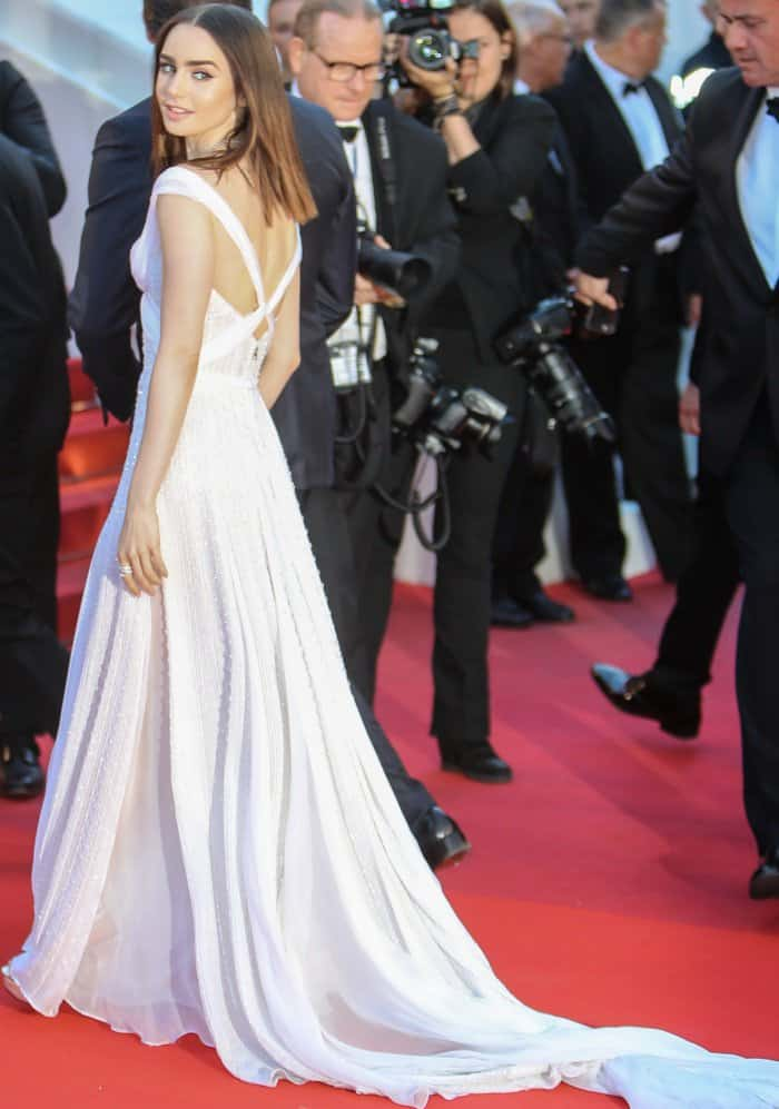"Lily Collins wearing a Ralph & Russo spring 2017 couture gown and Charlotte Olympia ""Isadora"" sandals at the 70th Cannes Film Festival ""Okja"" premiere"
