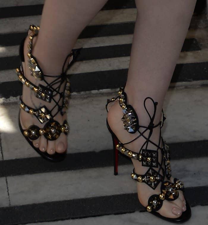 "Lily Collins wearing Christian Louboutin ""Kaleikita"" sandals at the BBC Radio 2 studios in London"