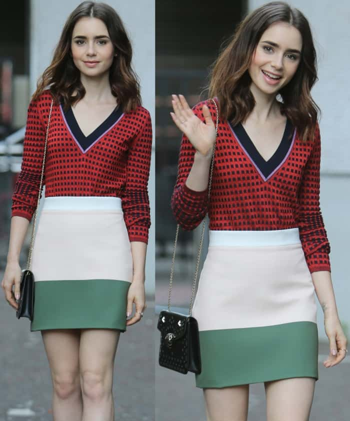 "Lily Collins wearing a red patterned top, By Johnny color block skirt, and Charlotte Olympia ""Dolly"" pumps at the ITV studios in London"
