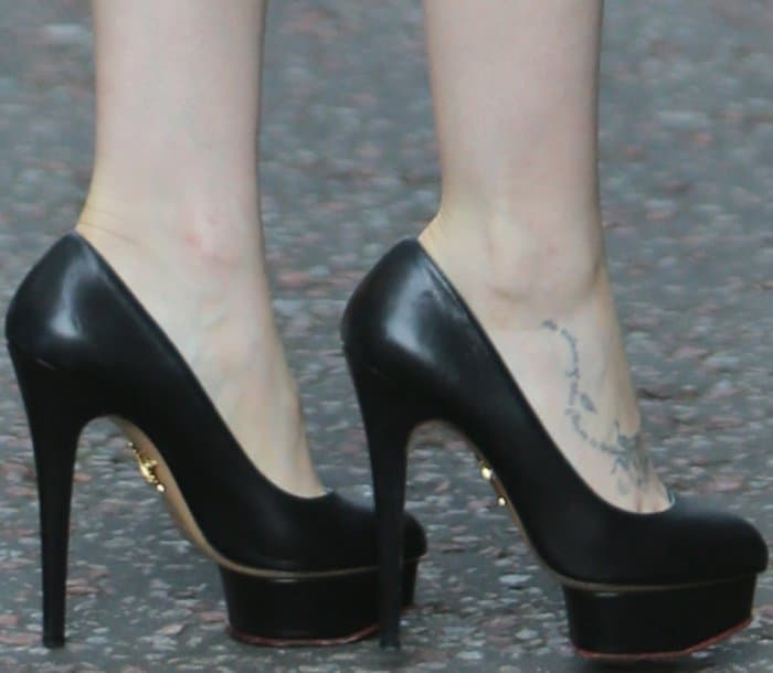 """Lily Collins wearing Charlotte Olympia """"Dolly"""" pumps at the ITV studios in London"""