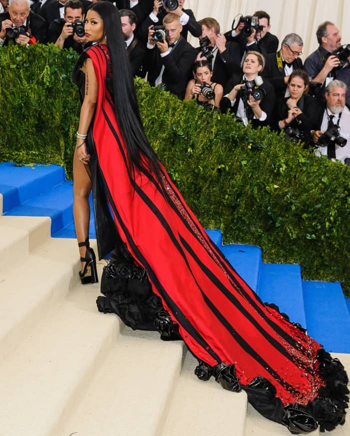 "Nicki Minaj wearing a custom H&M gown and Versace ""Medusa"" platform sandals at the 2017 Met Gala"