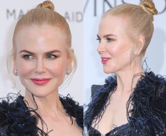 "Nicole Kidman wearing a black Chanel gown and Giuseppe Zanotti ""Georgina"" sandals at the 24th annual amfAR Gala during the 70th annual Cannes Film Festival"