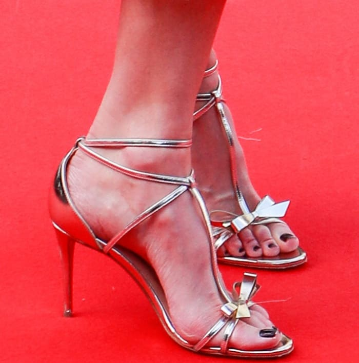 """Nicole Kidman wearing silver bow-embellished sandals at the """"How to Talk to Girls at Parties"""" premiere during the 70th annual Cannes Film Festival"""