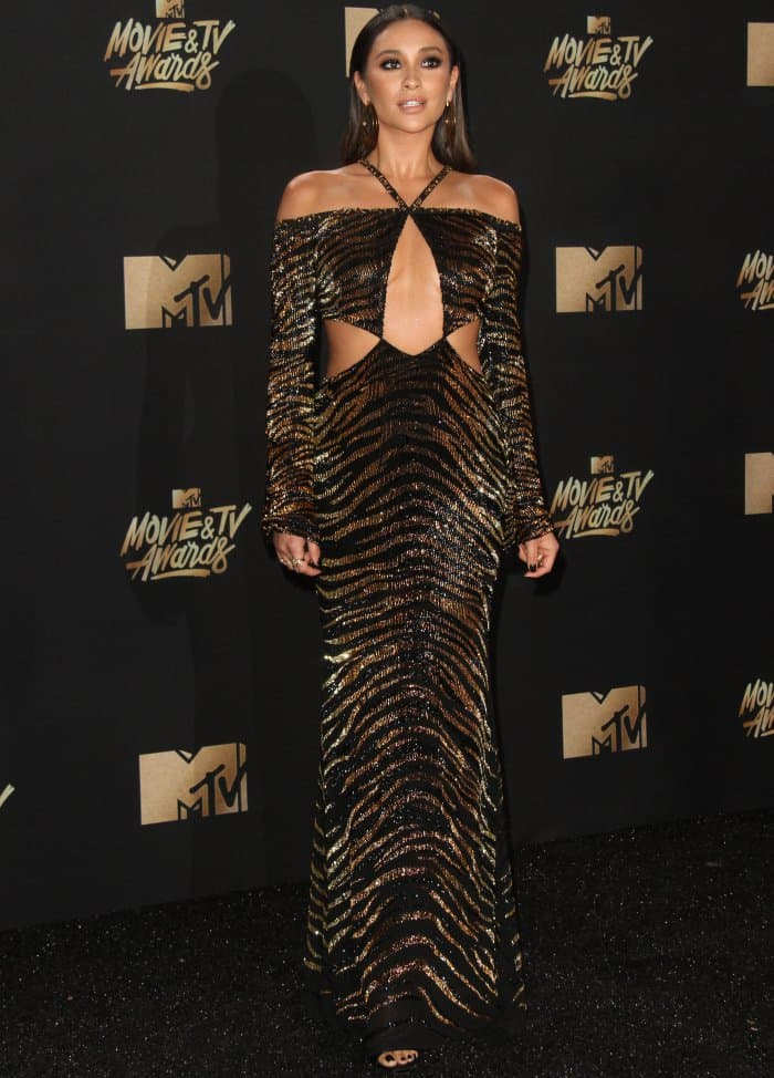 Shay Mitchell wearing a Roberto Cavalli dress and Giuseppe Zanotti sandals at the 2017 MTV Movie & TV Awards