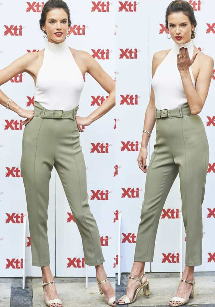 The leggy model posed for the cameras in a pair of Elisabetta Franchi trousers