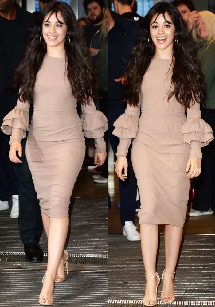 Camila Cabello looked sophisticated while flashing her legs in a nude-toned dress with ruffled sleeves
