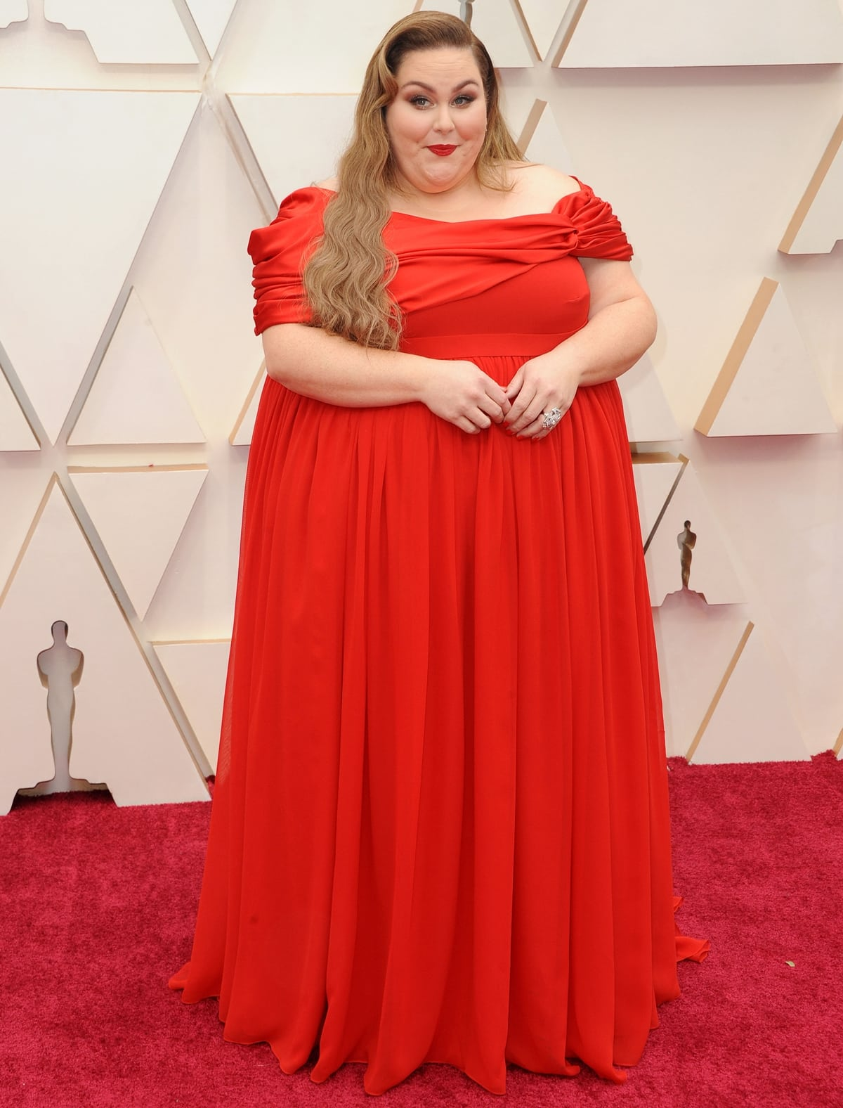 Chrissy Metz in a red off-the-shoulder dress by Christian Siriano at the 92nd Annual Academy Awards