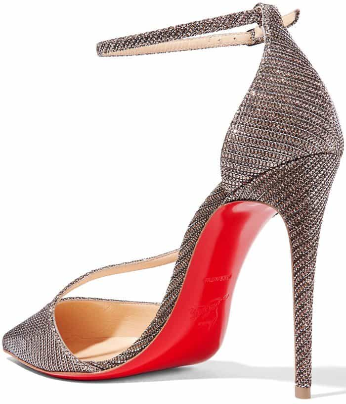 A slender band arcs across the vamp of a sultry pointy-toe sandal fitted with a slim ankle strap—while a lacquered red sole adds a flash of Louboutin color to every step
