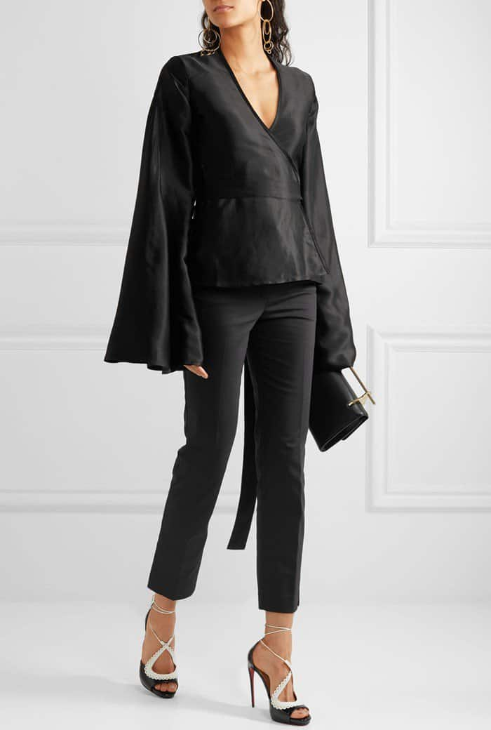 Model wearing the Operissima sandals with a 'Capella' satin-jacquard wrap blouse from Beaufille and cropped crepe slim-leg pants from Helmut Lang