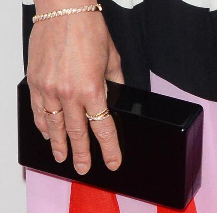 """Cobie squeezes in a bit of structure into her look with an Edie Parker """"Jean"""" clutch"""