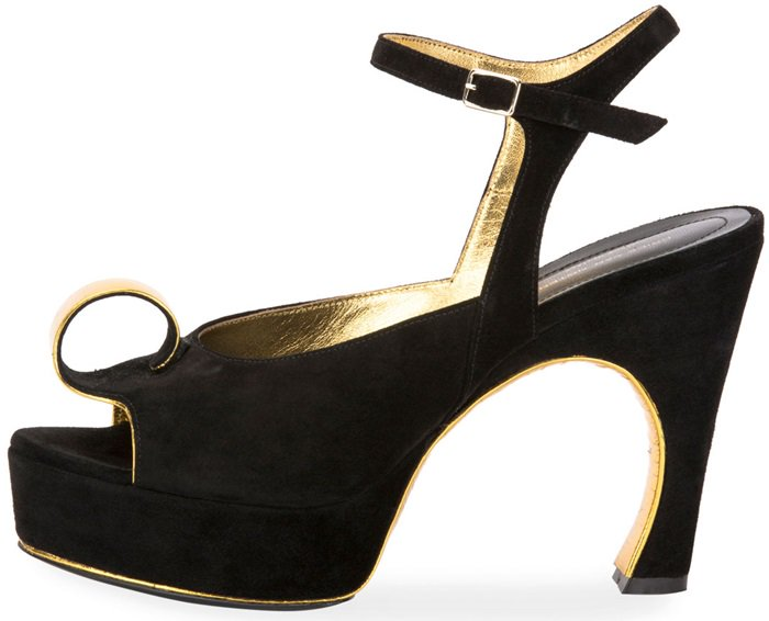 "This suede sandal from Dries Van Noten with metallic accents features an angled 3.2"" heel with high platform"