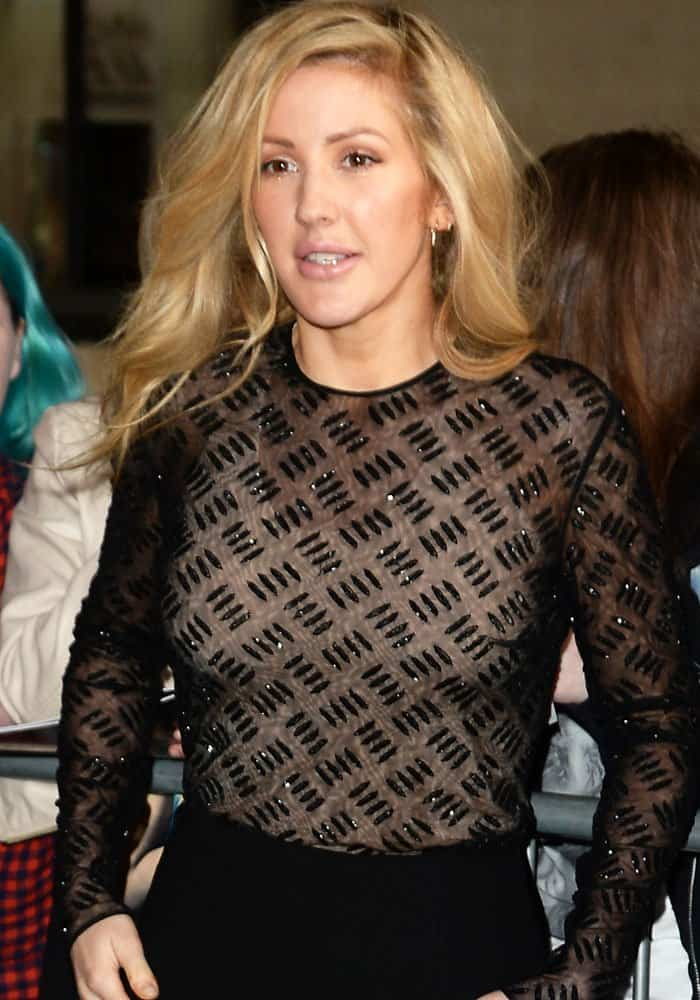 Ellie changed into a sheer jumpsuit for her radio video performance