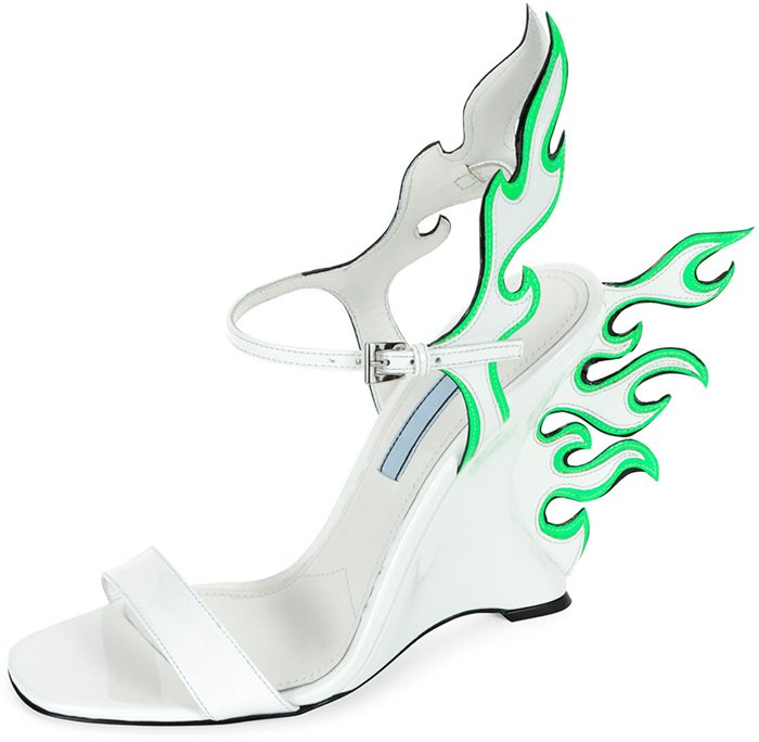 "This Prada leather sandal with contrast flame detail extending from back features 4.3"" covered wedge heel"