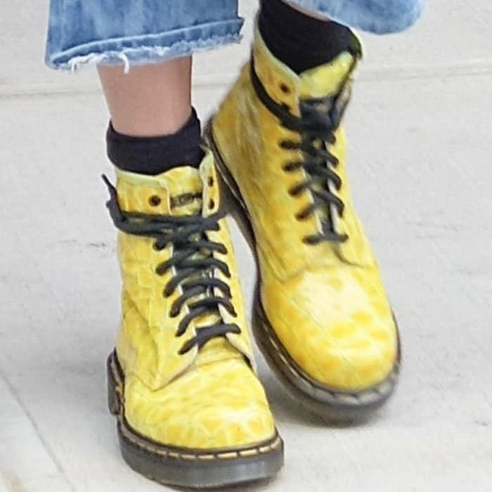 The young model goes boyish in a pair of Dr. Martens boots