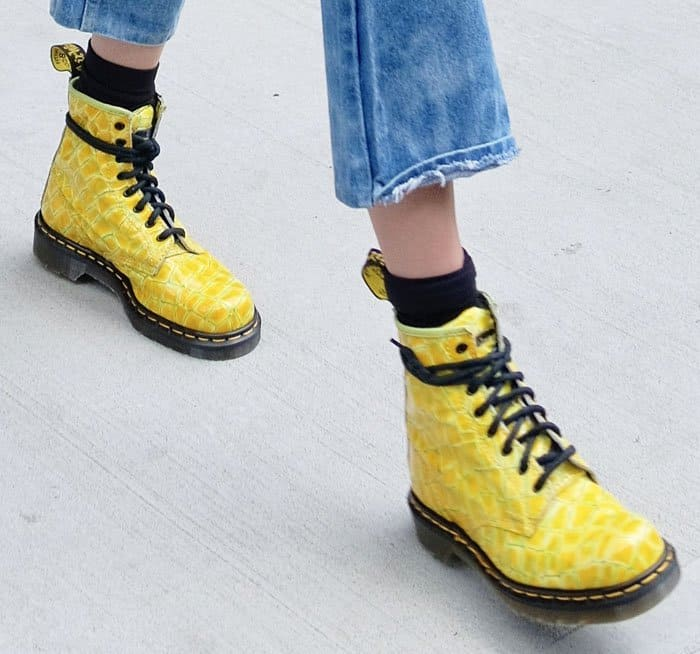 Gigi Hadid styled her cut off jeans with yellow Dr. Martens boots