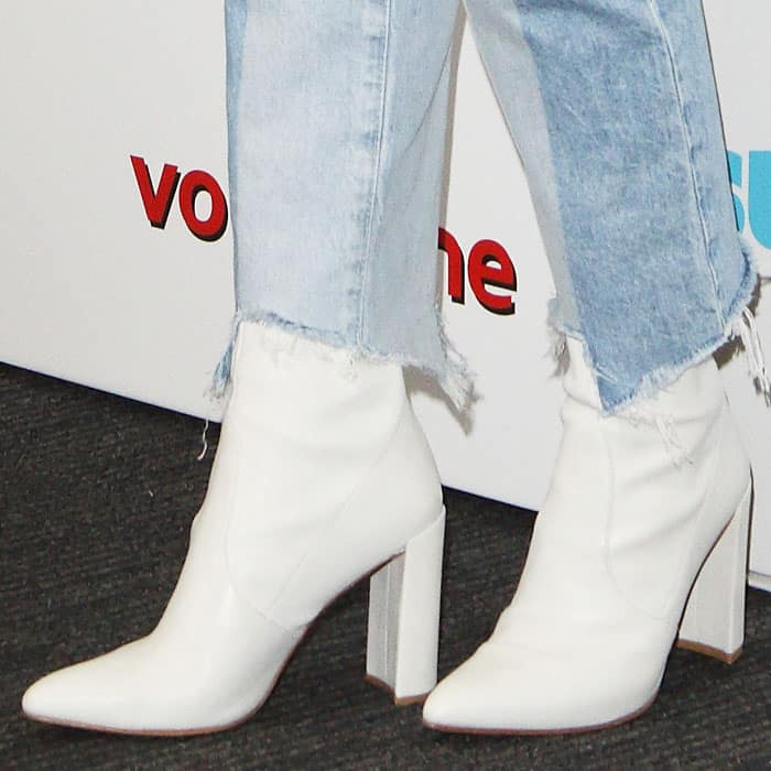 The actress adds a dash of sophistication to her look with a pair of white ankle boots