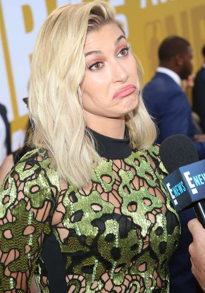 Hailey pauses to give a short interview with E! News