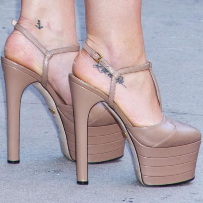 """The actress towers in a pair of Gucci """"Angel"""" platform pumps"""
