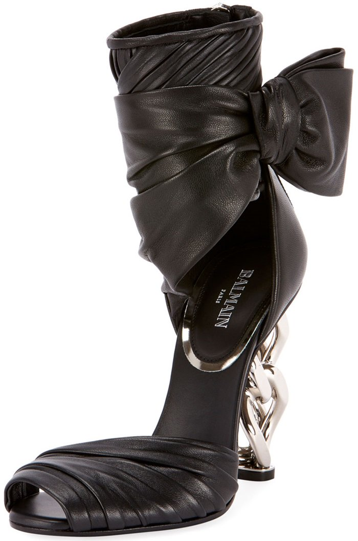 This Balmain sandal is rendered in leather and features an architectural heel and bow detail.