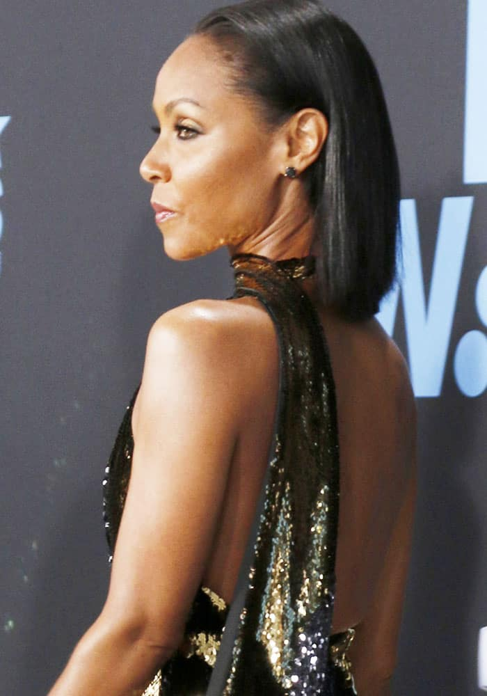 Jada shows off her bare back in the sparkly couture number