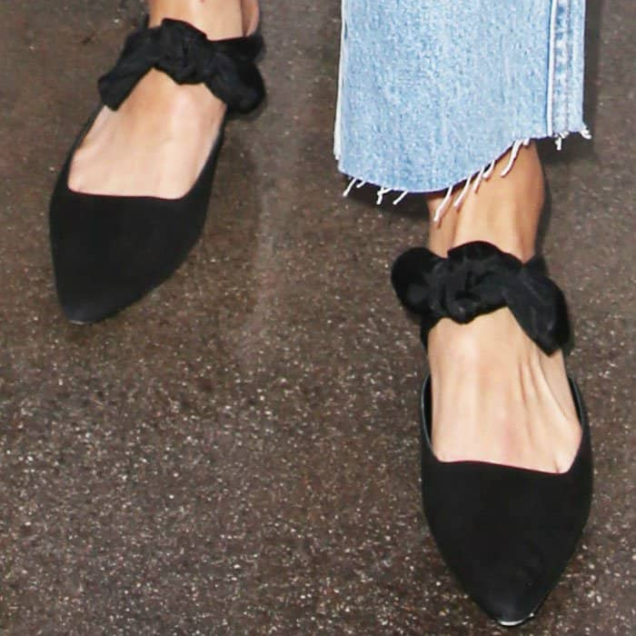 "Jamie wears a pair of suede bow ""Coco"" mules by The Row"
