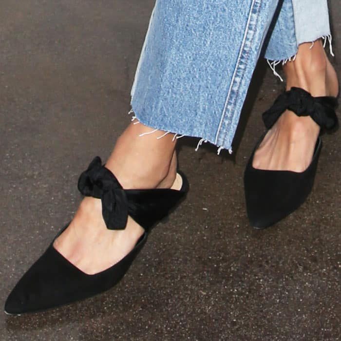 """Jamie wears a pair of suede bow """"Coco"""" mules by The Row"""