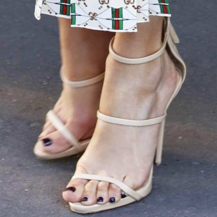"The stylish star paired her black pedicure with the Giuseppe Zanotti ""Harmony"" sandals"