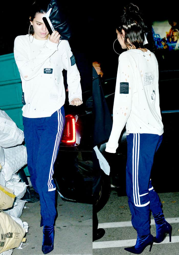 Kendall shows off a distressed athleisure look in Adidas x Alexander Wang track pants