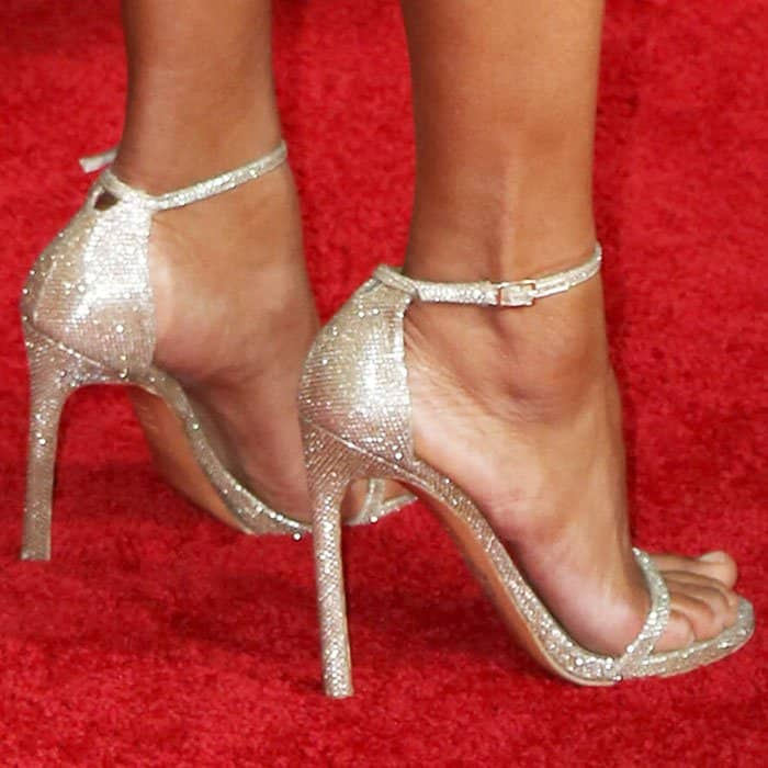 "Kerry adds some shine to her look with a pair of glitter Stuart Weitzman ""Nudist"" sandals"