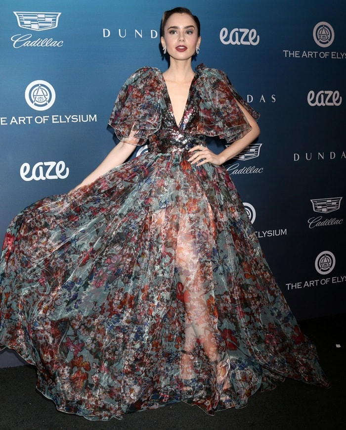 Lily Collins ina puffy sleeve printed organza gown from Elie Saab's Spring/Summer 2019 Collection