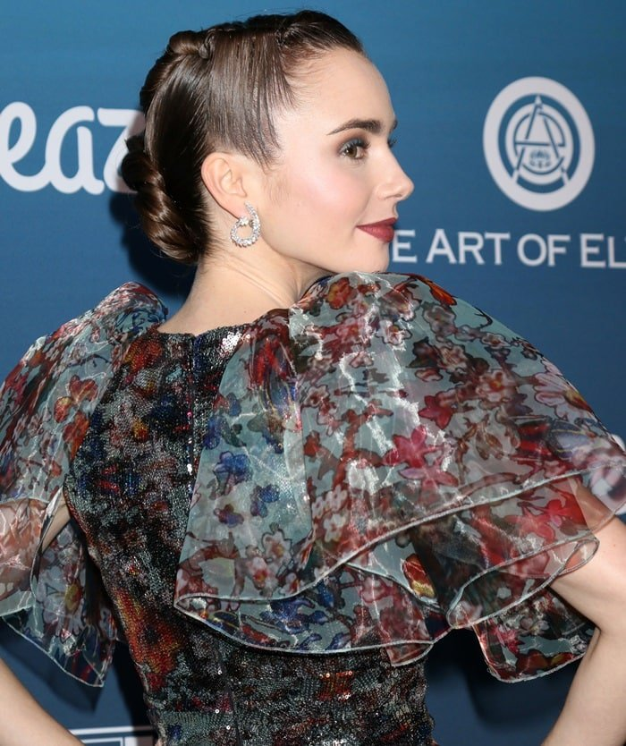 Lily Collins shows off her Yeprem's 18-karat white gold diamond earrings at the Art of Elysium event in Los Angeles on January 5, 2019