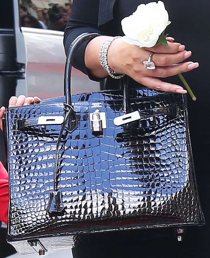 "Mariah goes classic with an Hermés ""Birkin"" tote in patent crocodile pattern leather"