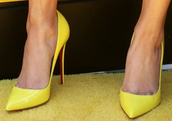 "Miranda pays homage to the Minions in a yellow pair of Christian Louboutin ""So Kate"" pumps"