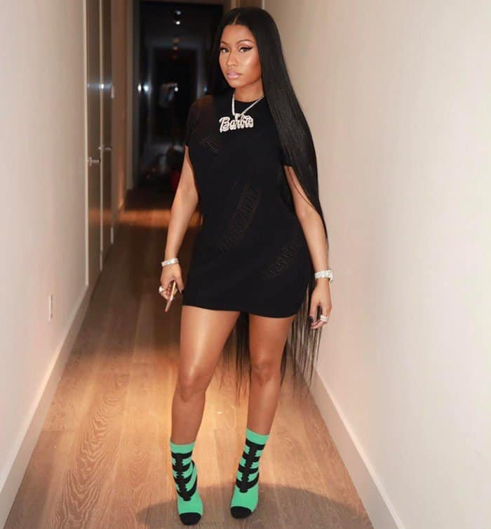 Photo shared by Nicki with the caption 'Fendi boot Barbie dress Versace'