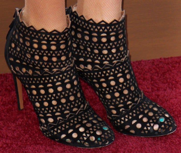 Paris Hilton kept the theme going with her Alaia laser cutout booties