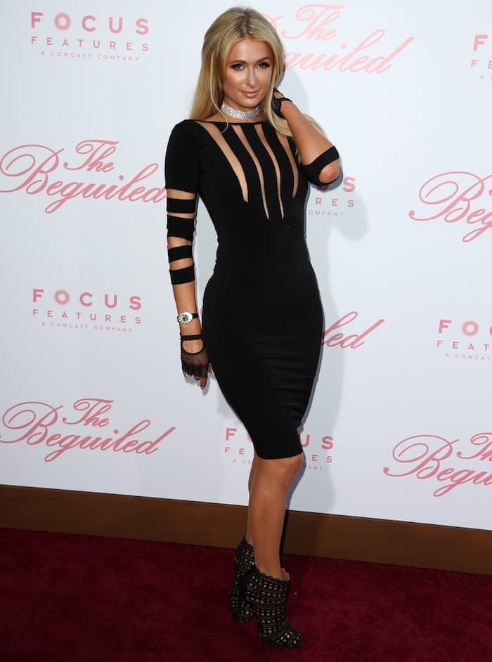 Paris Hilton in a black pencil dress from Hamel by Melina Harris