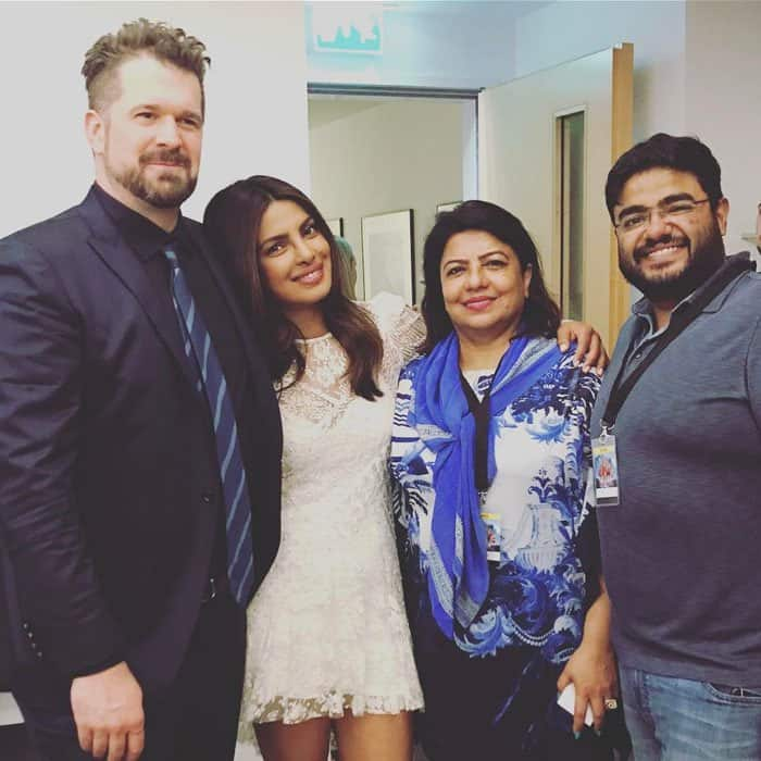 Priyanka takes a photo backstage after the Berlin photocall